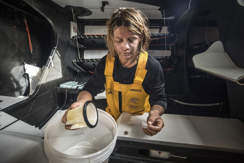 "In this Dec. 19, 2017 photo provided by Volvo Ocean Race, Liz Wardley works aboard the vessel, ""Turn the Tide on Plastic,"" during the race leg between"