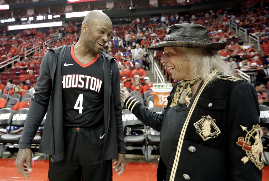 Houston Rockets' P.J. Tucker (4) talks with fan James Goldstein during halftime in Game 2 of the team's NBA basketball Western Conference finals again