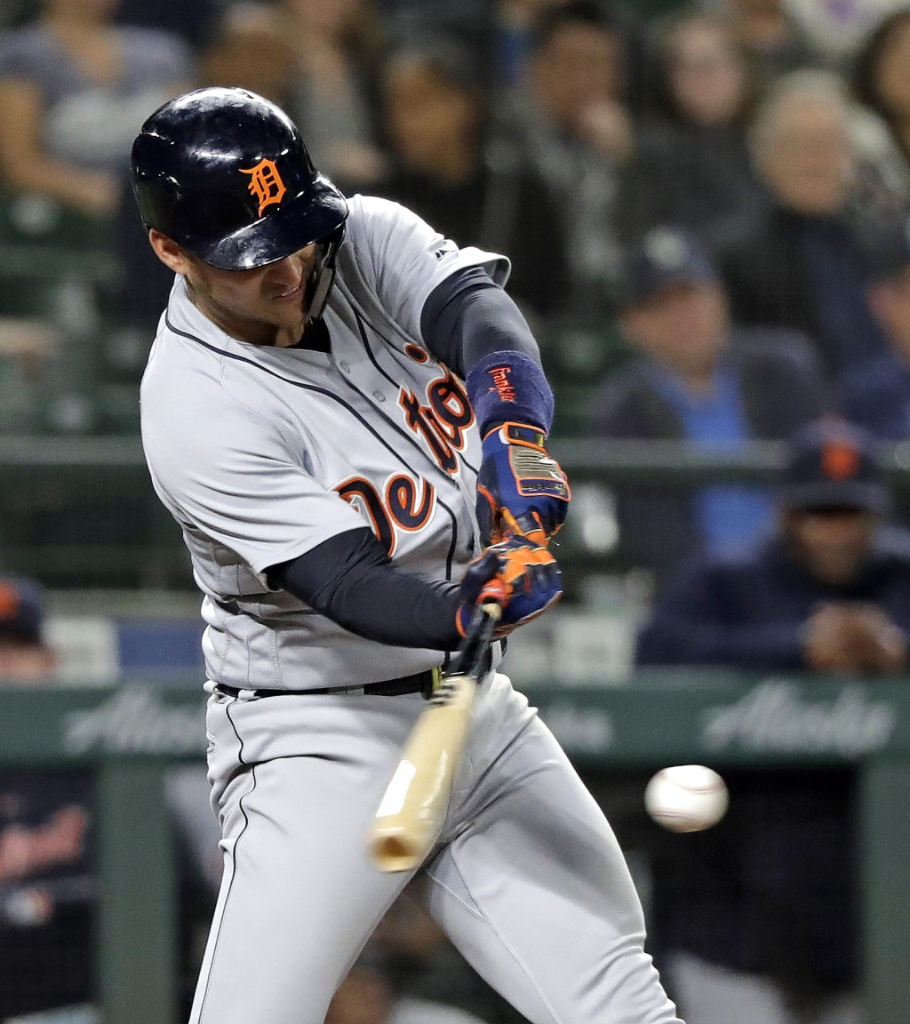 Detroit Tigers' Jose Iglesias singles in a pair of runs against the Seattle Mariners during the eighth inning of a baseball game Thursday, May 17, 201