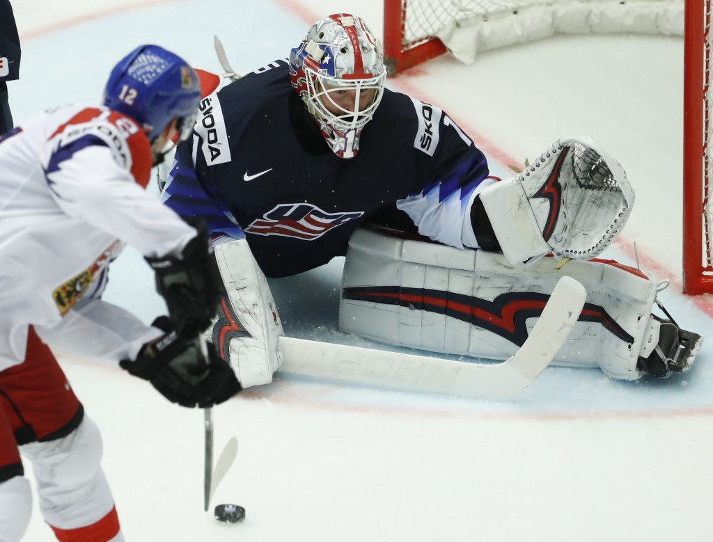 Keith Kinkaid, right, of the United States makes a save against Czech Republic's Radek Faksa, left, during the Ice Hockey World Championships quarterf