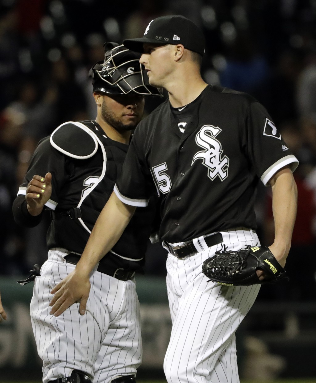 Chicago White Sox catcher Welington Castillo, left, celebrates with relief pitcher Nate Jones after the White Sox defeated the Texas Rangers 4-2 in a