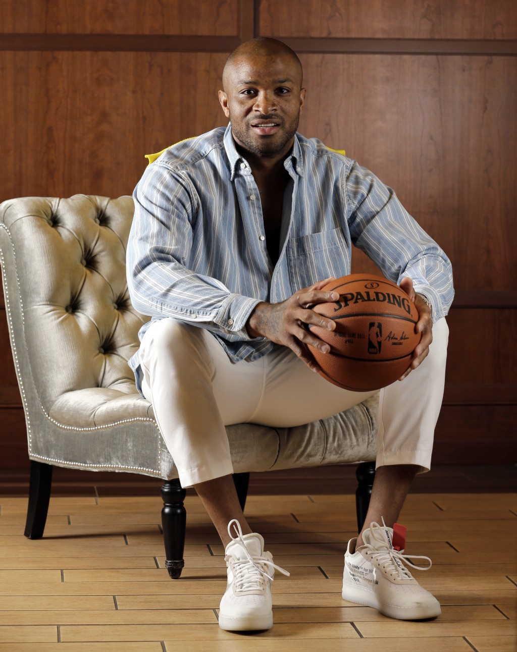 Houston Rockets' P.J. Tucker poses in a button-down Balenciaga shirt, white Alexander McQueen trousers and Off-White X Nike Air Force 1 shoes Tuesday,