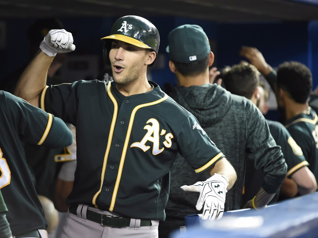 Oakland Athletics' Matt Olson (28) celebrates with teammates after hitting a home run during the fifth inning against the Toronto Blue Jays in a baseb