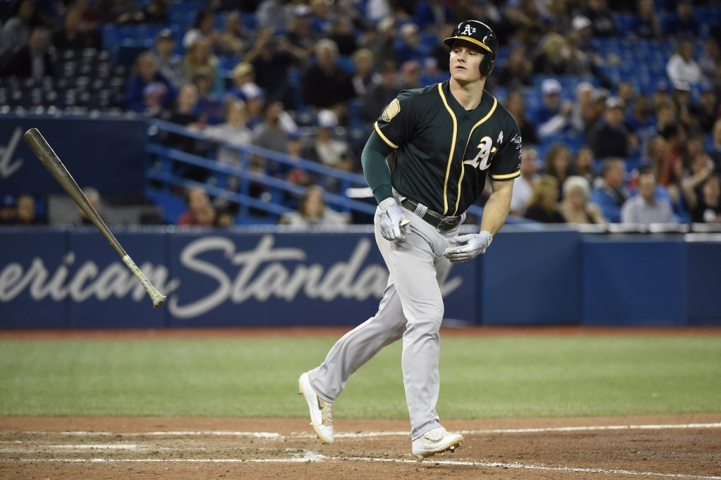 Oakland Athletics third baseman Matt Chapman heads to first on a walk during the eighth inning of a baseball game against the Toronto Blue Jays on Thu