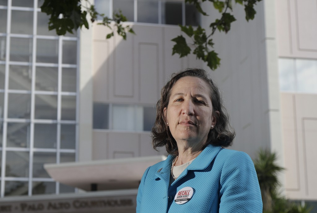 In this May 14, 2018 photo, Stanford law professor Michele Dauber poses for photos outside of the Palo Alto Courthouse in Palo Alto, Calif. Judge Aaro