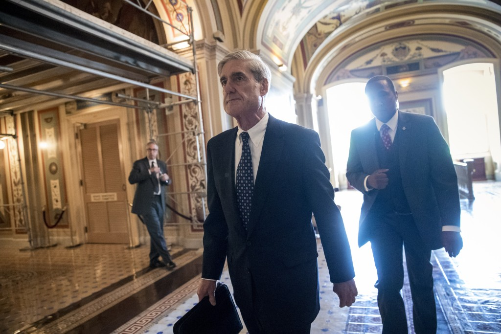 FILE - In this June 21, 2017, file photo, Special Counsel Robert Mueller departs after a closed-door meeting with members of the Senate Judiciary Comm