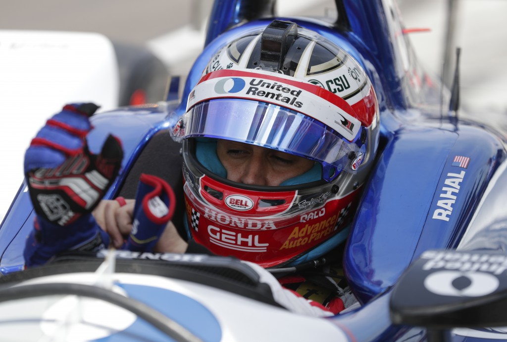 Graham Rahal pulls on his gloves as he prepare to drive during a practice session for the IndyCar Indianapolis 500 auto race at Indianapolis Motor Spe