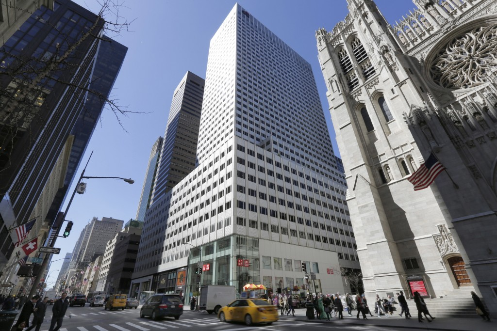 FILE - This March 29, 2017, file photo shows the 666 Fifth Avenue skyscraper, center, controlled by Kushner Cos., in New York. The company owned by th