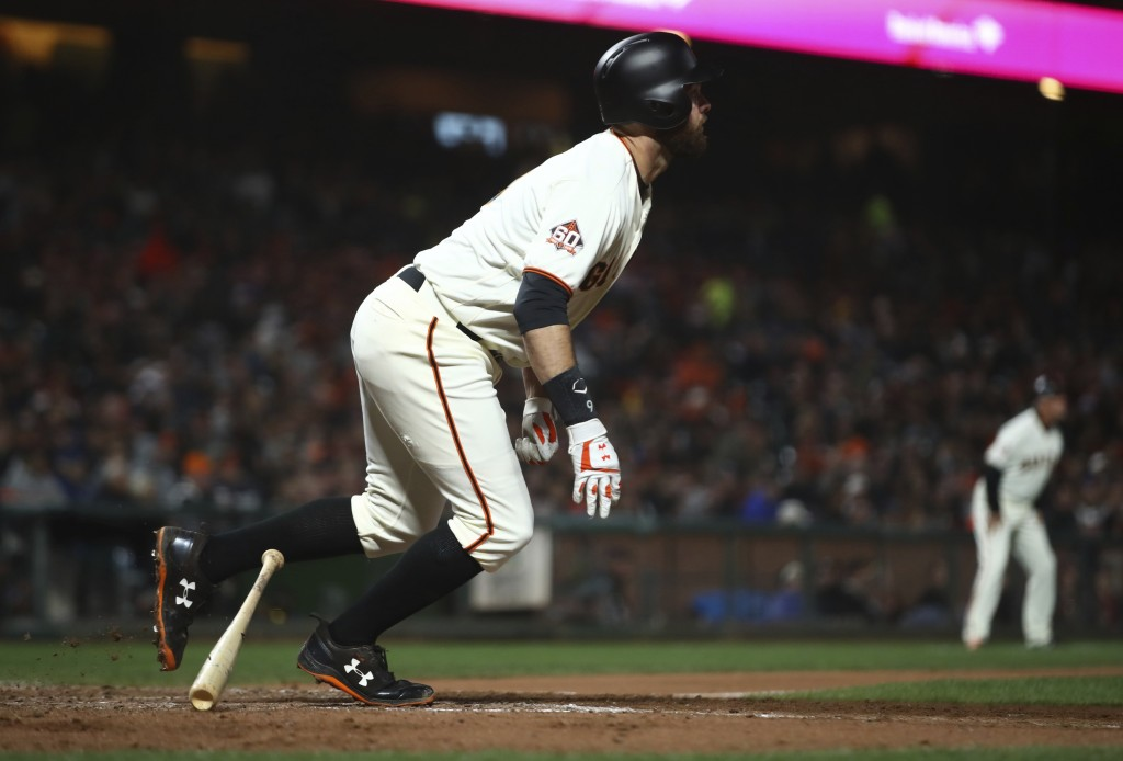 San Francisco Giants' Brandon Belt watches his two-run home run off Colorado Rockies pitcher Chad Bettis during the sixth inning of a baseball game Th