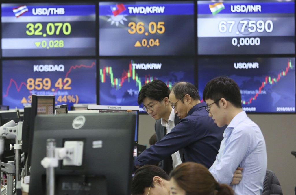 Currency traders watch monitors at the foreign exchange dealing room of the KEB Hana Bank headquarters in Seoul, South Korea, Friday, May 18, 2018. As