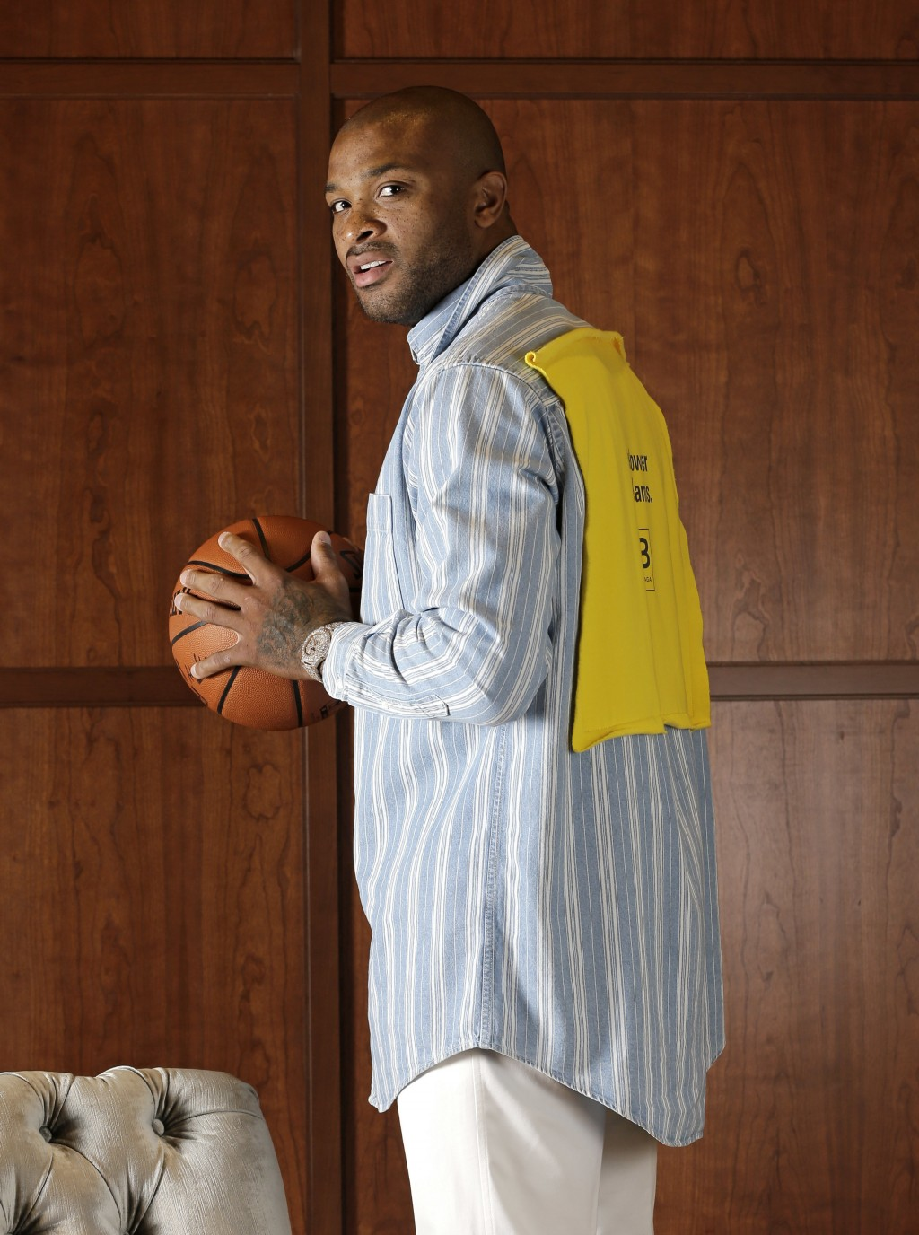 Houston Rockets' P.J. Tucker poses in a button-down Balenciaga shirt, and white Alexander McQueen trousers Tuesday, May 15, 2018, in Houston. Tucker's