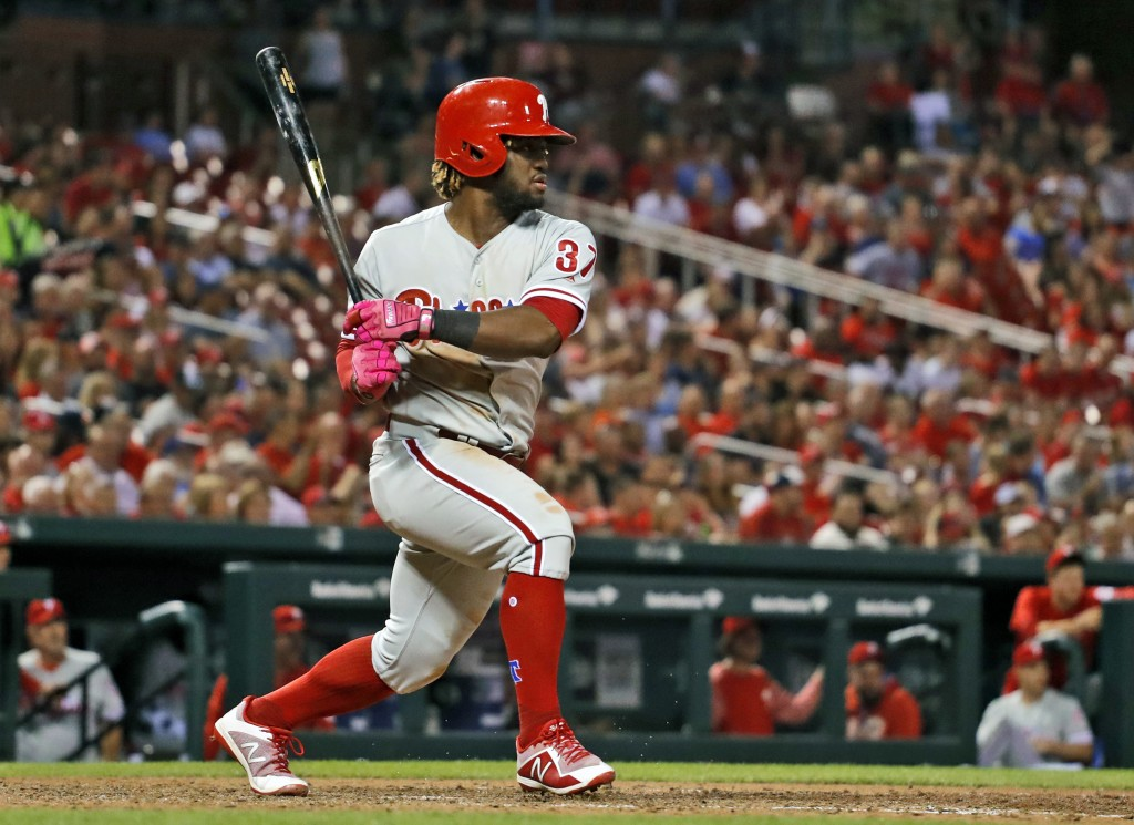 Philadelphia Phillies' Odubel Herrera watches his RBI-double during the eighth inning of a baseball game against the St. Louis Cardinals, Thursday, Ma