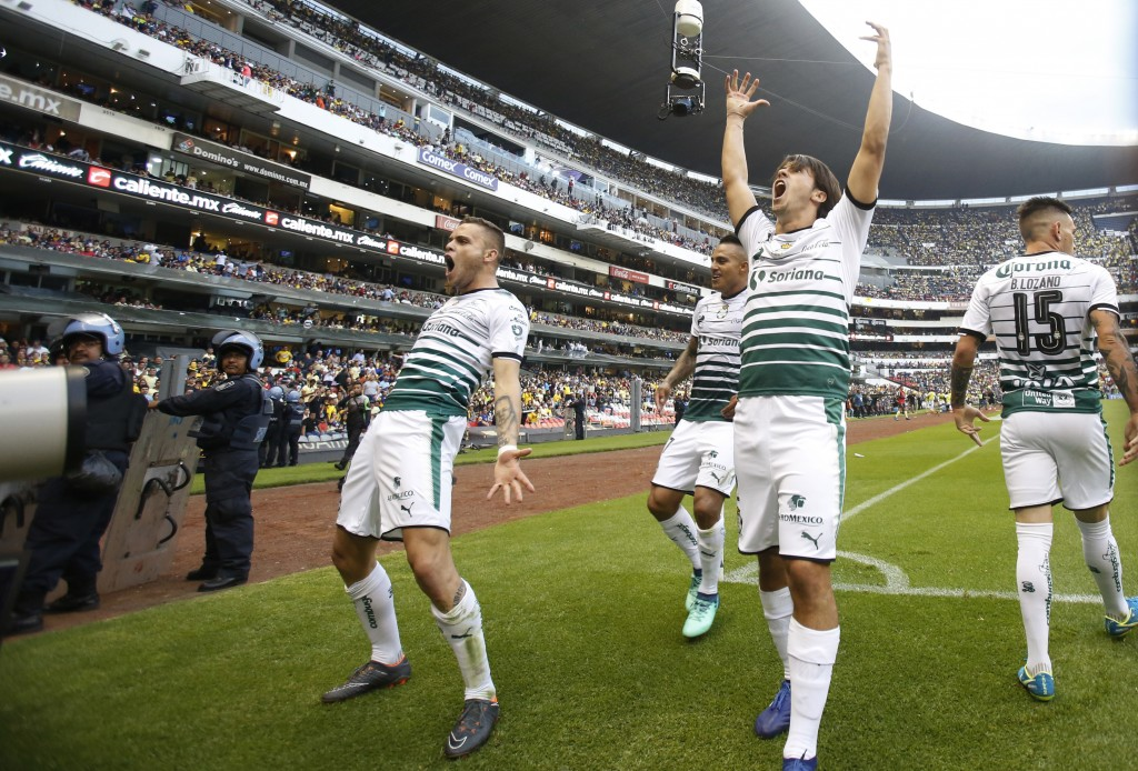 In this Sunday, May 13, 2018 photo, Santos soccer players celebrate their team's goal against America during a Mexican league second-leg semifinal mat