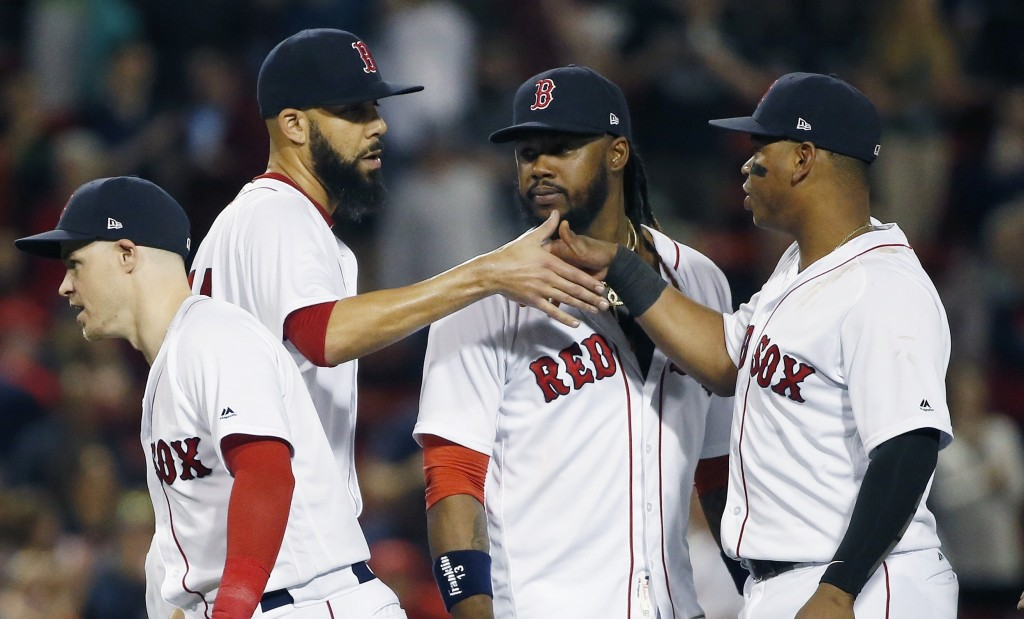 Boston Red Sox's David Price, second from left, celebrates with teammates, from left, Brock Holt, Hanley Ramirez and Rafael Devers after the Red Sox d