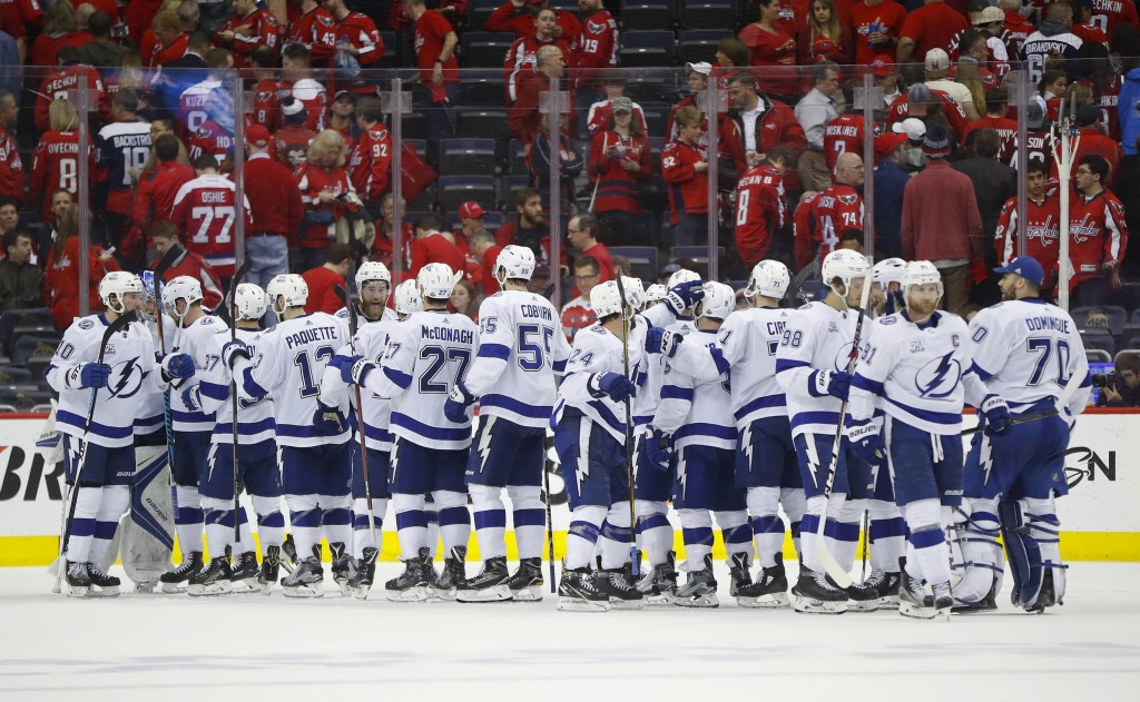 Members of the Tampa Bay Lightning celebrate on the ice at the end of Game 4 of the NHL Eastern Conference finals hockey playoff series against Washin