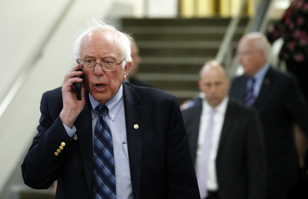 Sen. Bernie Sanders, I-Vt., talks on his phone as he departs after a vote on Gina Haspel to be CIA director, on Capitol Hill, Thursday, May 17, 2018 i