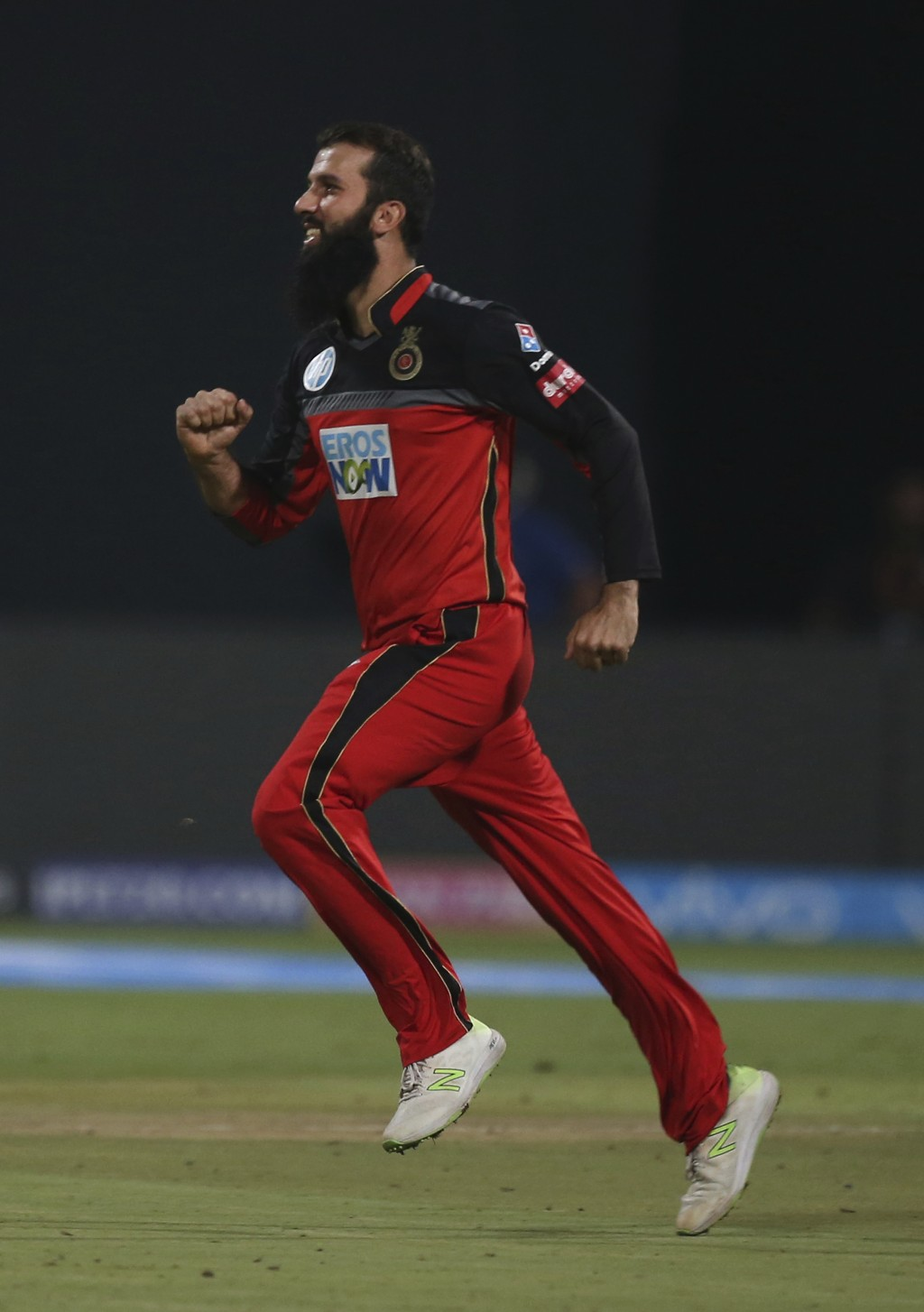 Royal Challengers Bangalore's Moeen Ali runs to celebrate the dismissal of Sunrisers Hyderabad batsman Alex Hales during the VIVO IPL Twenty20 cricket