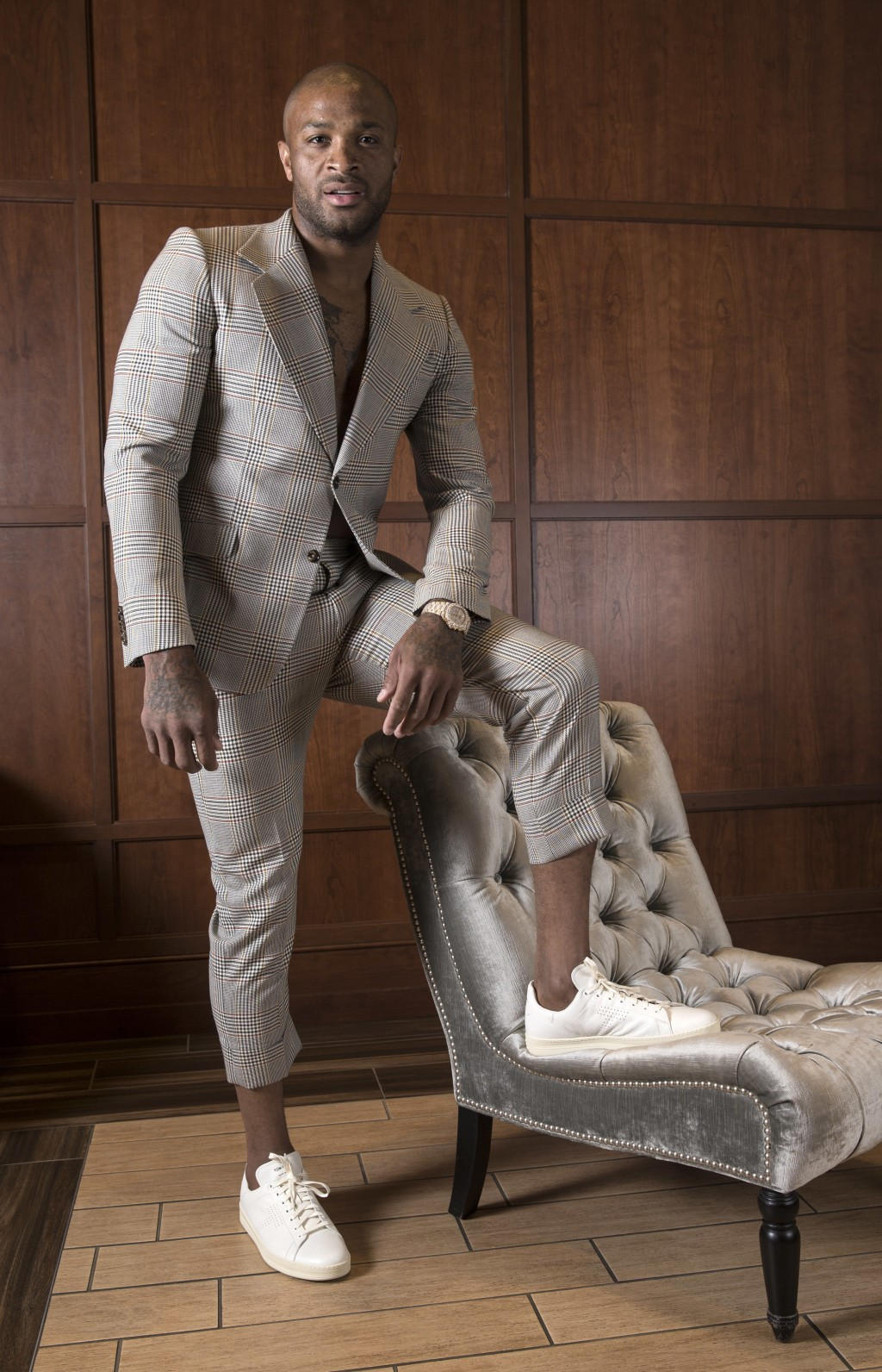Houston Rockets' P.J. Tucker poses in a made-to-order Gucci suit with Tom Ford sneakers Tuesday, May 15, 2018, in Houston. Tucker's playing style and
