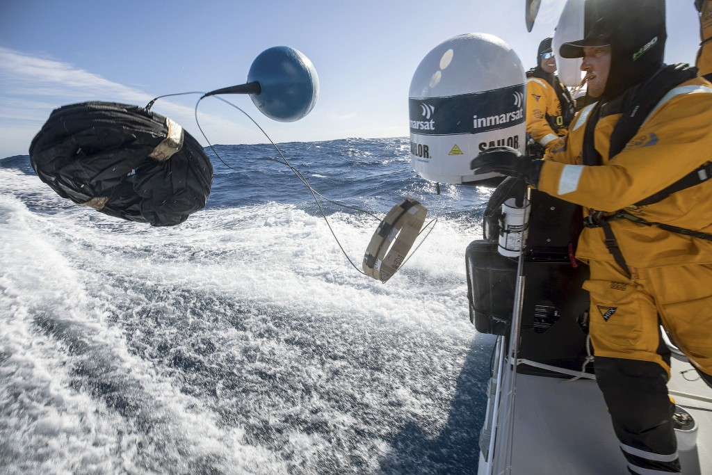 In this March 21, 2018 photo provided by Volvo Ocean Race, Frederico de Melo deploys a scientific drifter to test the water for evidence of pollution