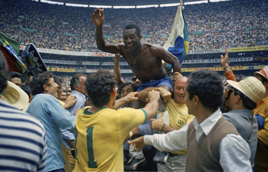 FILE - In this June 21, 1970 file photo, Brazil's Pele, center, is hoisted on the shoulders of his teammates after Brazil won the World Cup soccer fin