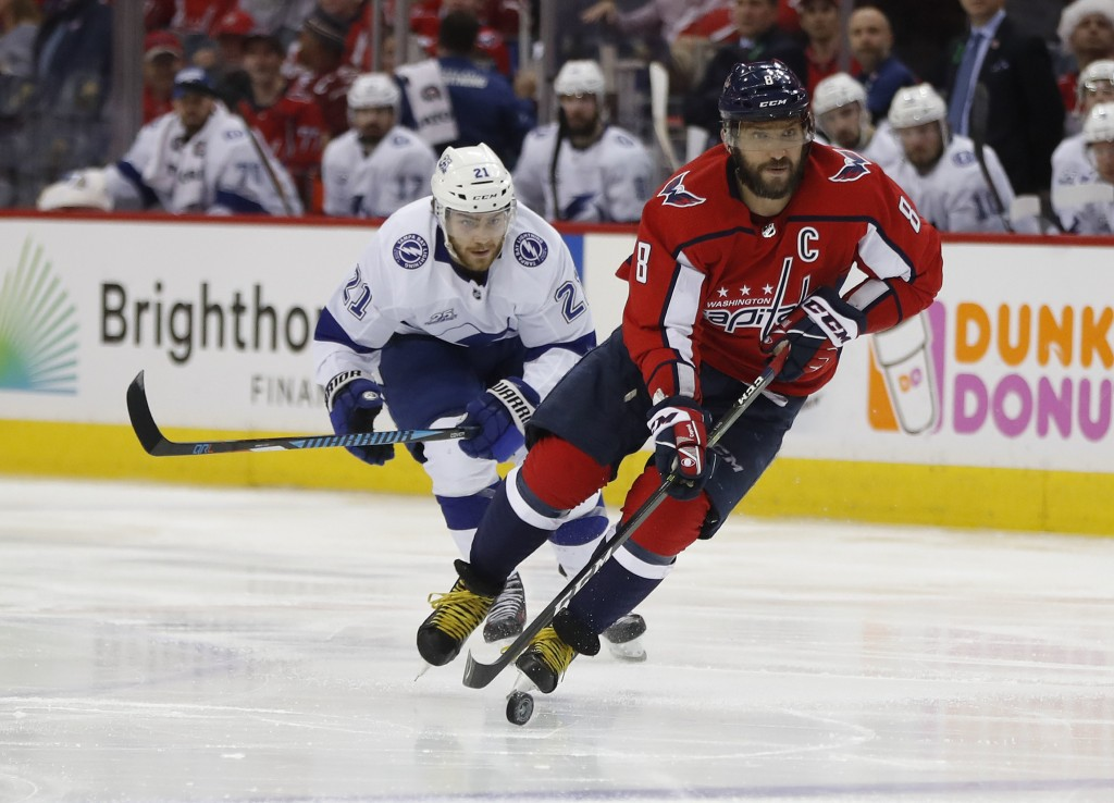 Washington Capitals left wing Alex Ovechkin (8), skates past Tampa Bay Lightning center Brayden Point (21) during the second period of Game 4 of the N