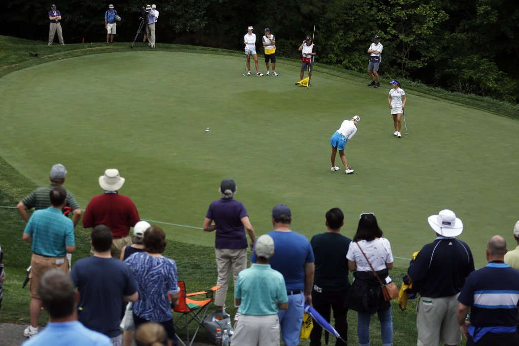 Michelle Wie reacts after coming up short on the 13th hole during the first round of the LPGA Tour's Kingsmill Championship golf tournament Thursday,