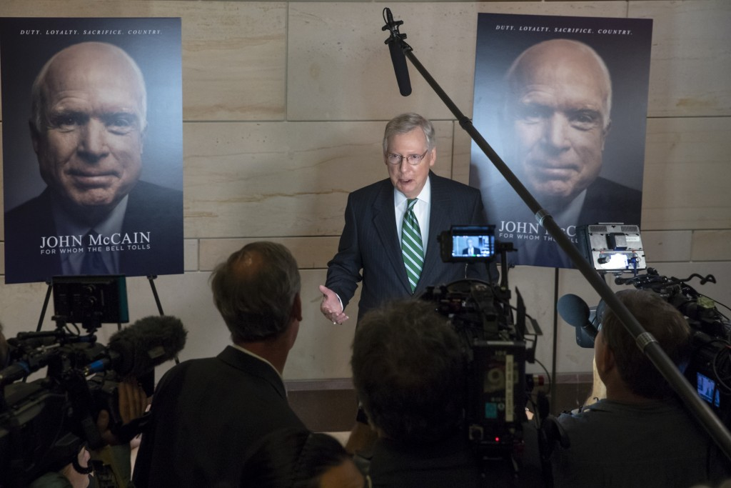 Senate Majority Leader Mitch McConnell, R-Ky., and other lawmakers stop by an event on Capitol Hill during the debut a documentary film about Sen. Joh