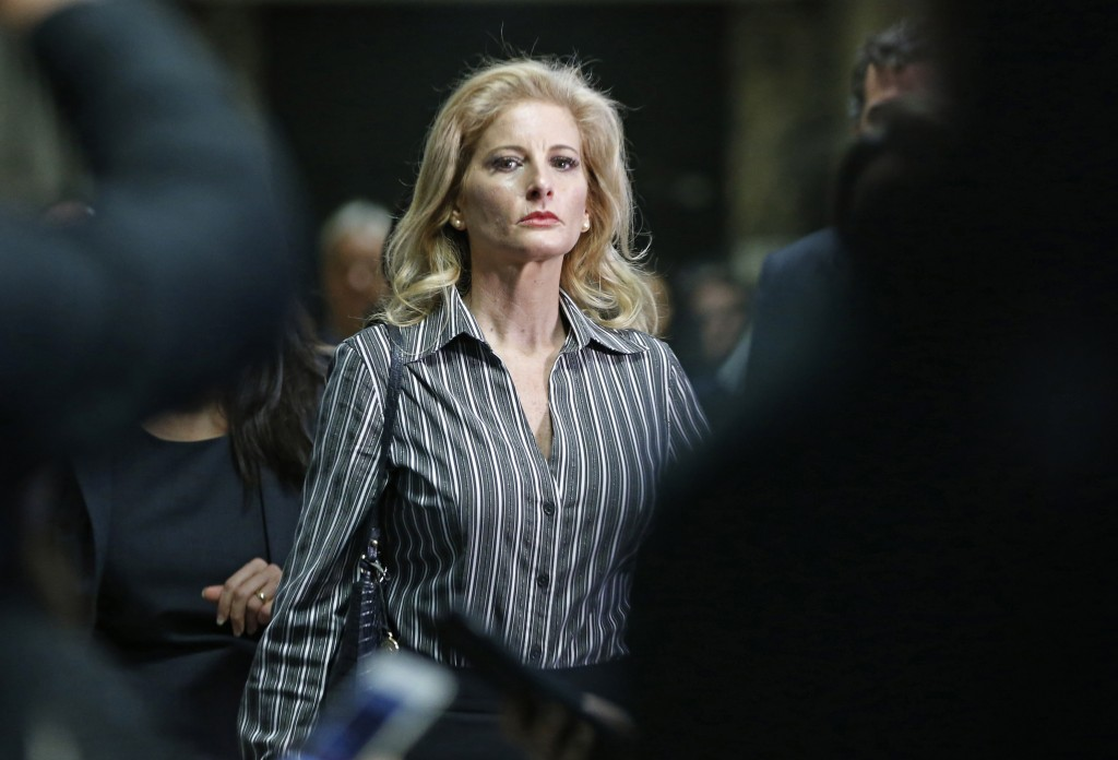 FILE- In this Dec. 5, 2017 file photo, Summer Zervos leaves Manhattan Supreme Court at the conclusion of a hearing in New York. A New York court said