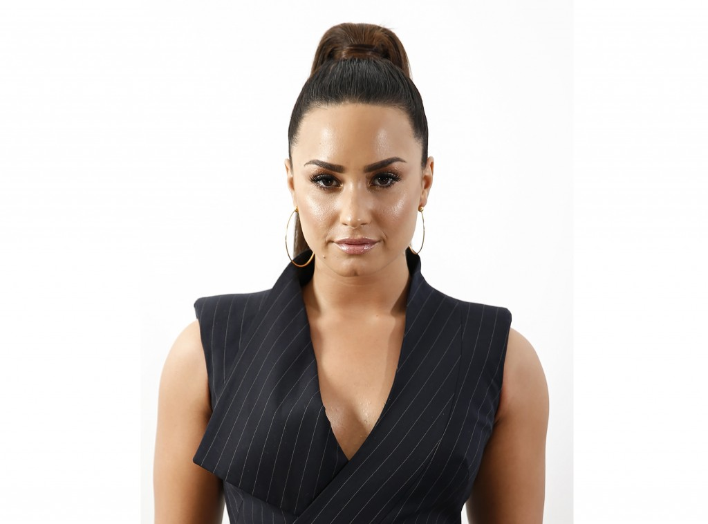"FILE - In this Sept. 6, 2017 file photo, Demi Lovato poses for a portrait to promote her new album, ""Tell Me You Love Me"", in New York. Lovato, who li"