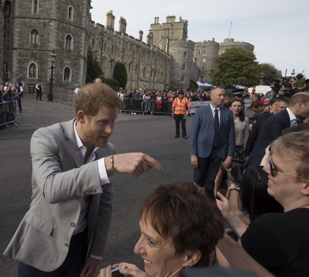 Britain's Prince Harry, left and Prince William greet well-wishers outside Windsor castle, in Windsor, England, Friday, May 18, 2018 ahead of Prince H...