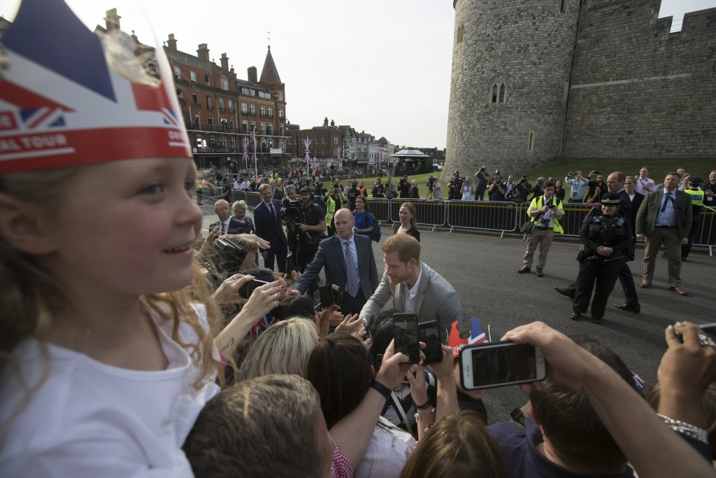 Britain's Prince Harry, centre and Prince William greet well-wishers outside Windsor castle, in Windsor, England, Friday, May 18, 2018 ahead of Prince...