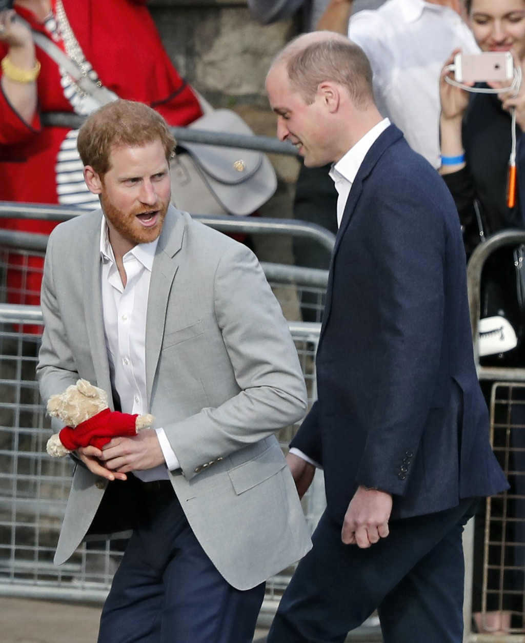 Britain's Prince William, right, and Prince Harry return to Windsor Castle after greeting crowds in Windsor, near London, England, Friday, May 18, 201...