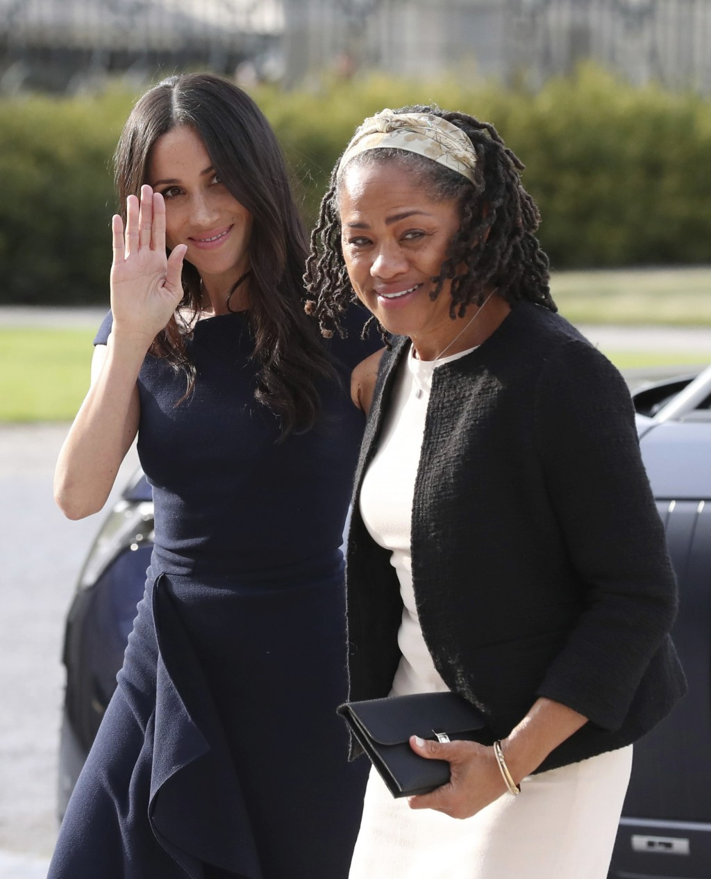 Meghan Markle, left and her mother, Doria Ragland, arrive at Cliveden House Hotel, in Berkshire, England, Friday, May 18, 2018 to spend the night befo...