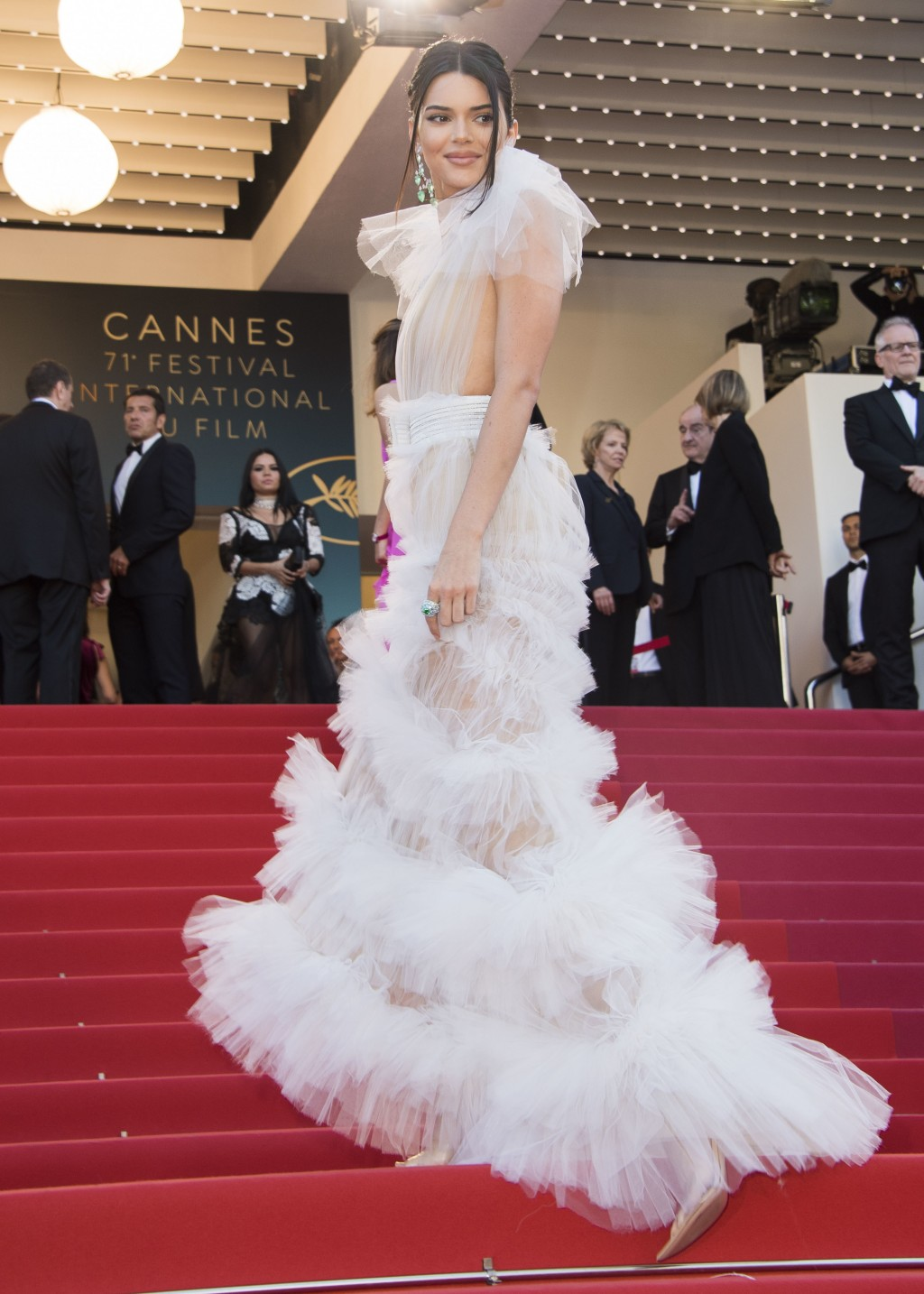d1e3575f22d Model Kendall Jenner wears a white tiered tulle Schiaparelli gown at the  premiere of