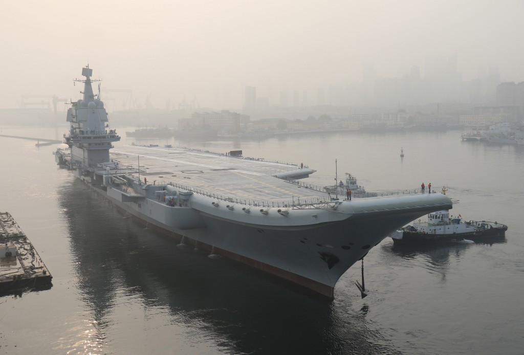 FILE - In this May 13, 2018, file photo provided by China's Xinhua News Agency, China's indigenous aircraft carrier lifts anchor in Dalian in northeas...