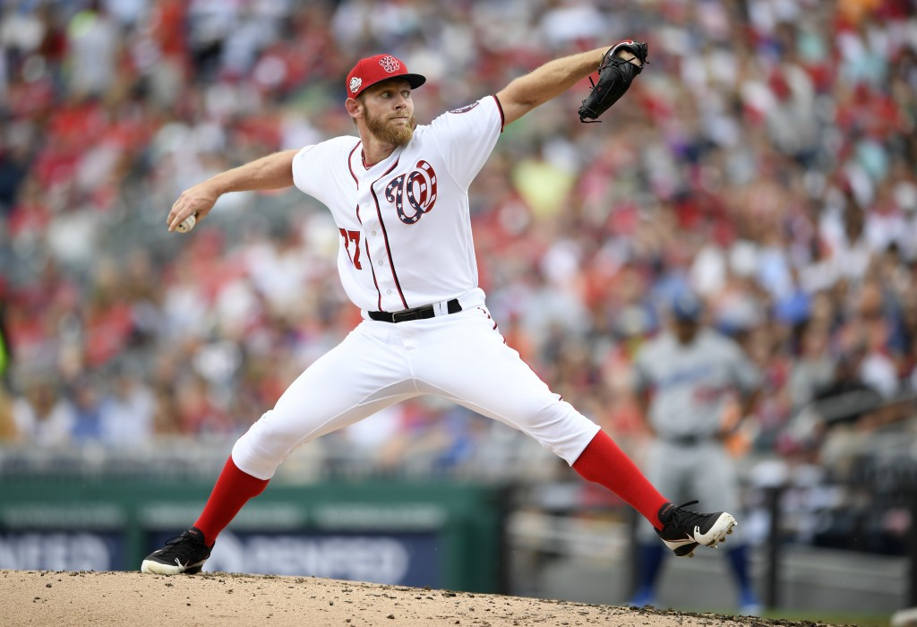 Washington Nationals starting pitcher Stephen Strasburg delivers during the third inning of a baseball game against the Los Angeles Dodgers, Sunday, M