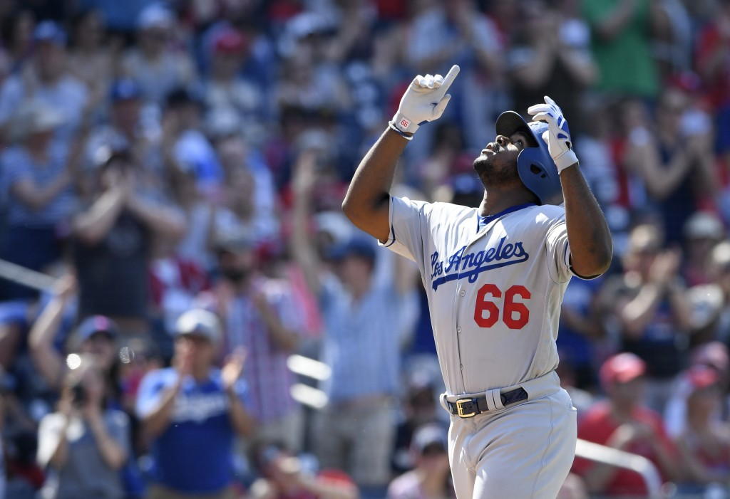 Los Angeles Dodgers' Yasiel Puig celebrates his two-run home run during the eighth inning of a baseball game against the Washington Nationals, Sunday,