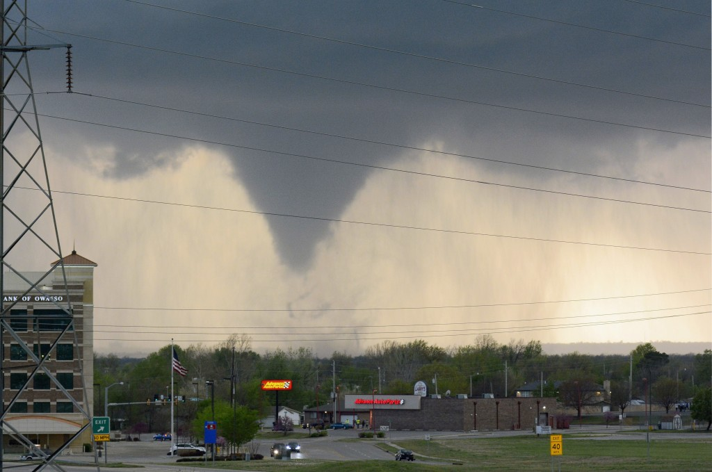 FILE - In this March 30, 2016, file photo, a tornado touches down in Tulsa, Okla. The eruption of Mount Kilauea in Hawaii is a reminder to business ow...