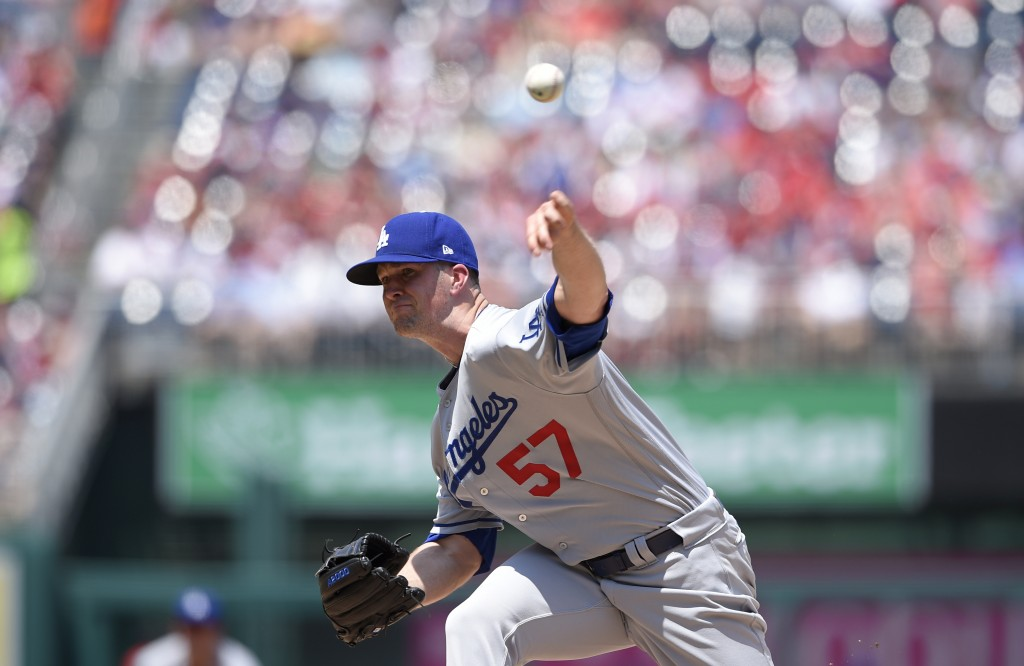 Los Angeles Dodgers starting pitcher Alex Wood delivers during the first inning of a baseball game against the Washington Nationals, Sunday, May 20, 2