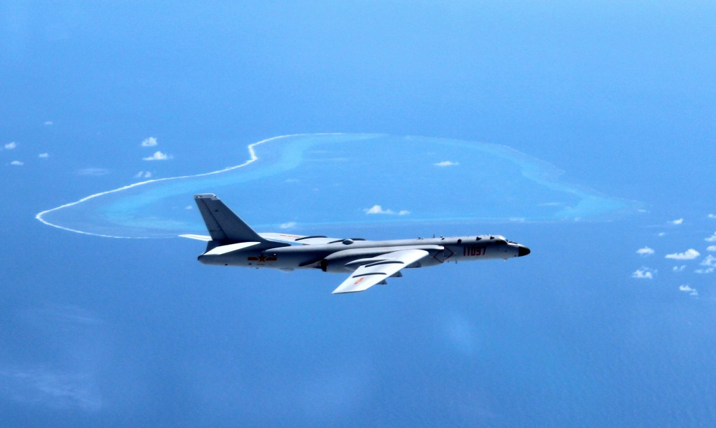 FILE - In this undated file photo released by Xinhua News Agency, a Chinese H-6K bomber patrols the islands and reefs in the South China Sea. The Chin...