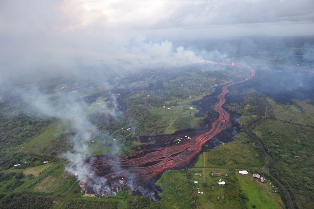 FILE- In this Saturday, May 19, 2018, file photo released by the U.S. Geological Survey, lava emerges from fissures near Pahoa, Hawaii. The eruption o...
