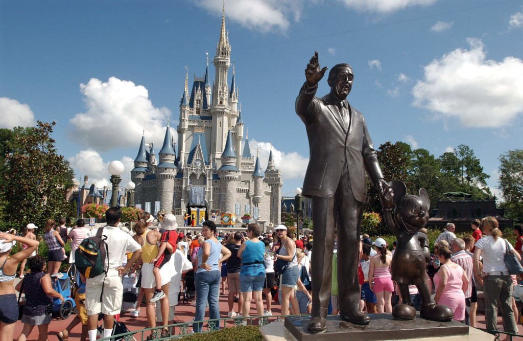 FILE - In this Sept. 2, 2004, file photo, tourists crowd around Cinderella's Castle to watch a performance at Walt Disney World's Magic Kingdom in Lak...