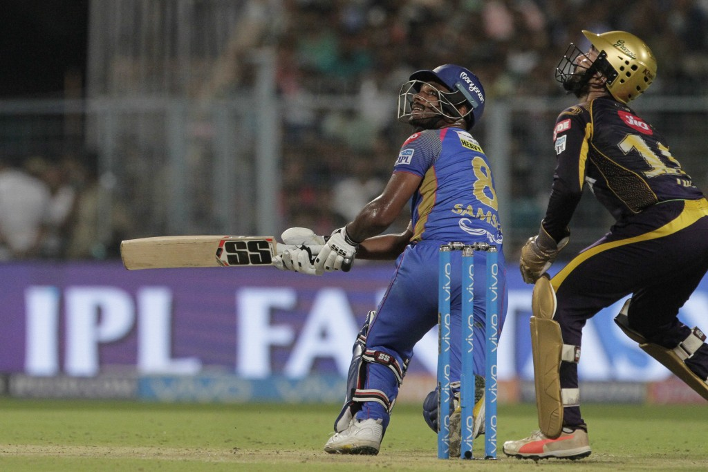 Rajasthan Royals' Sanju Samson bats as Kolkata Knight Riders' Dinesh Karthik, right looks up for the ball during the VIVO IPL cricket T20 match in Kol