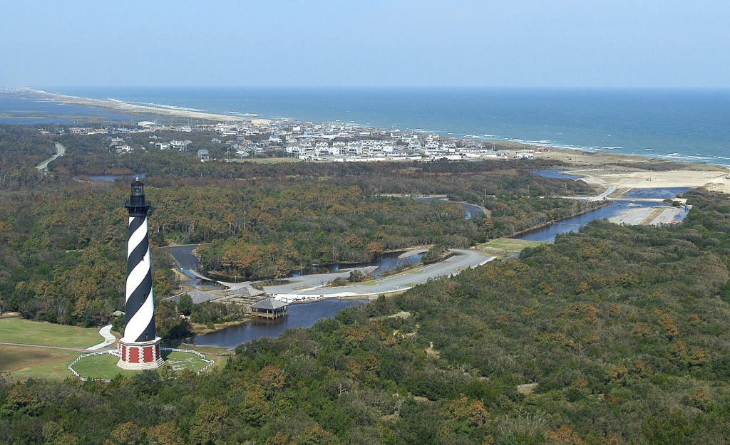 FILE - This 2003, file photo, shows the Cape Hatteras Lighthouse overlooking the Atlantic Ocean and the village of Buxton, N.C. Lighthouse Beach in Bu...
