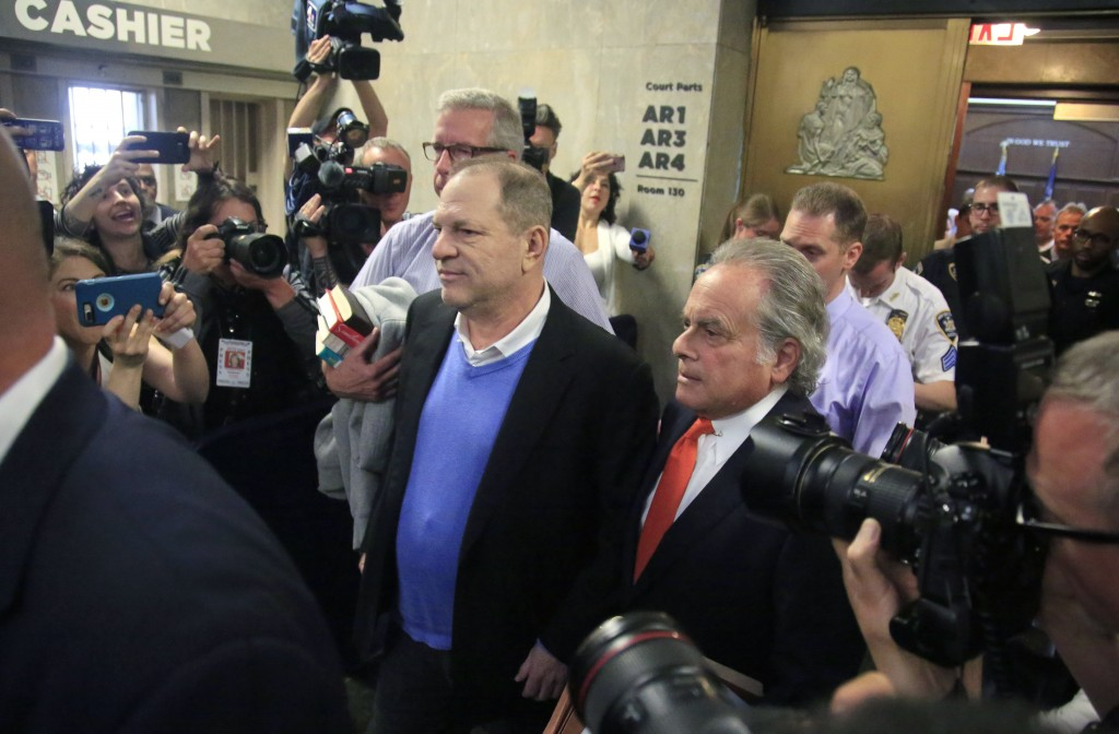 Harvey Weinstein, center, leaves with his lawyer Benjamin Brafman, right, after posting bail at Manhattan's Criminal Court, Friday, May 25, 2018, in N...