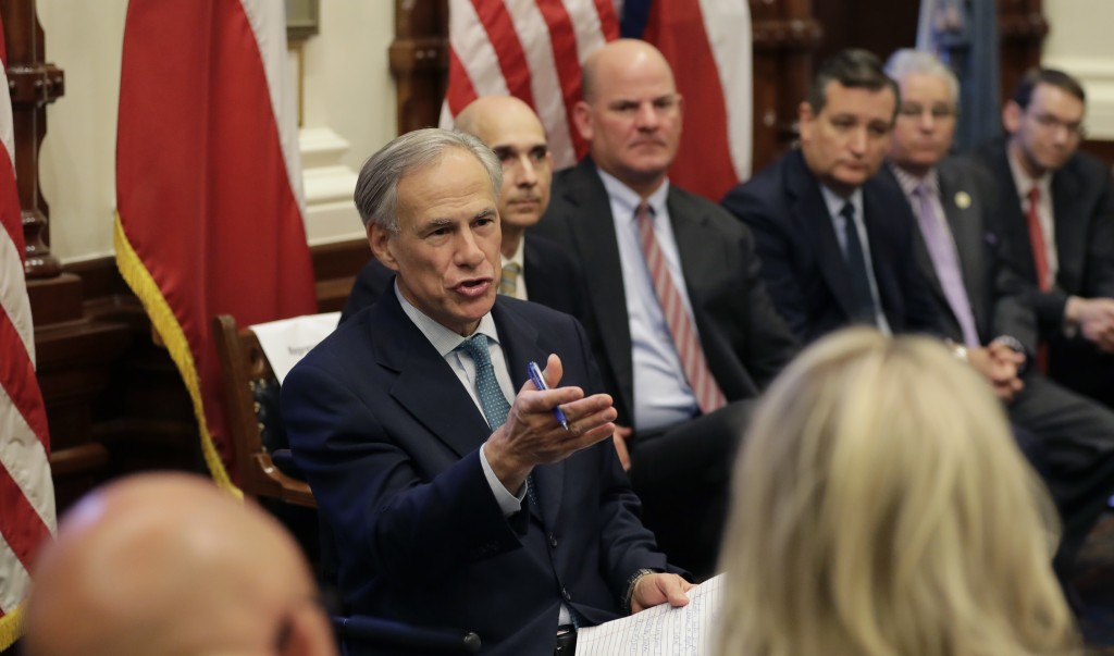 Texas Gov. Gregg Abbott, left, hosts a roundtable discussion in Austin, Texas, Thursday, May 24, 2018, to address safety and security at Texas schools...