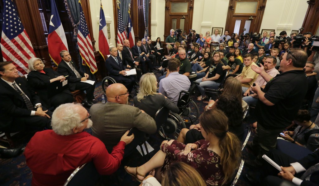 Scot Rice, standing right, speaks during a roundtable discussion in Austin, Texas, Thursday, May 24, 2018, hosted by Texas Gov. Gregg Abbott to addres...