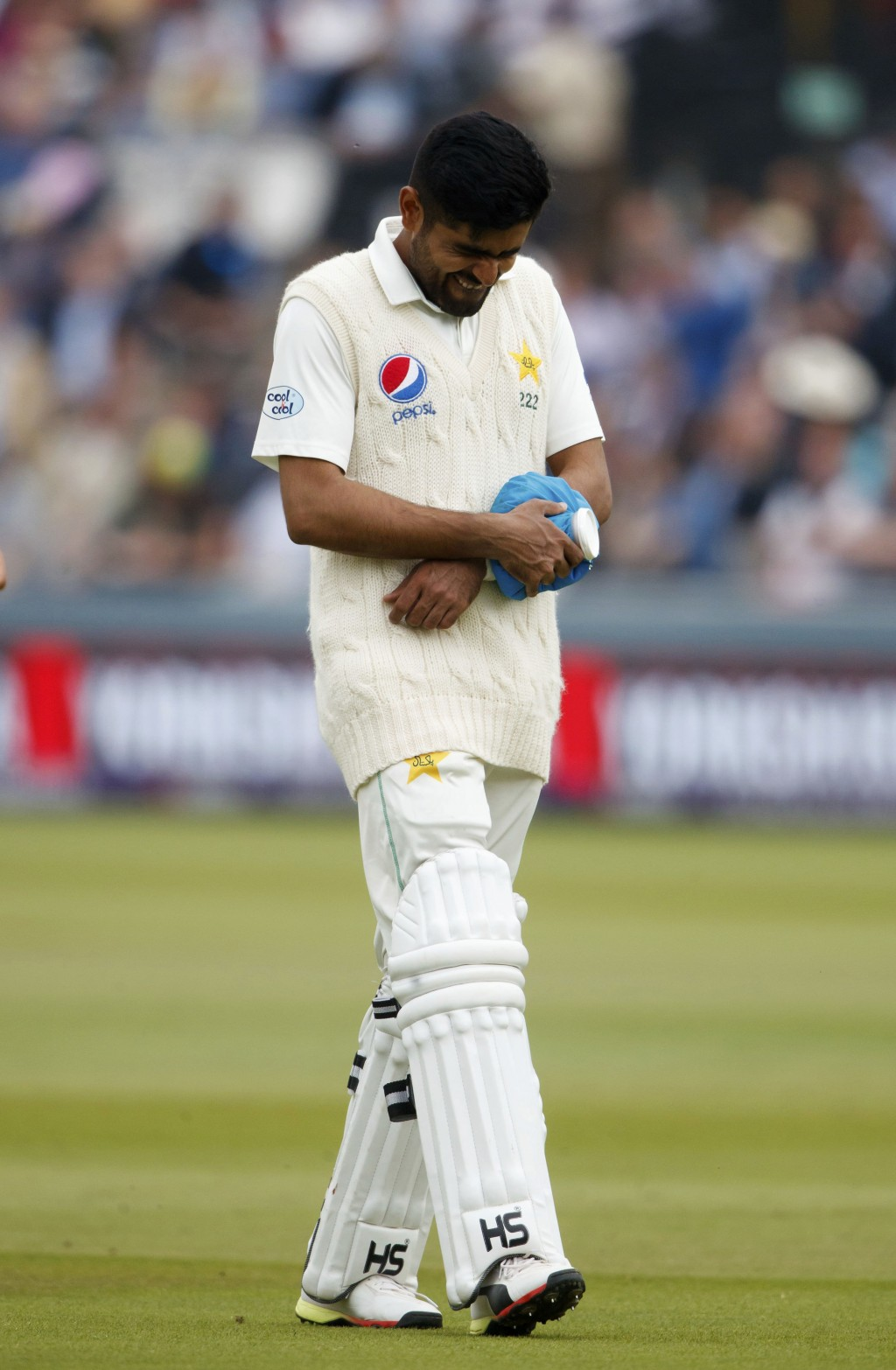 Pakistan's Babar Azam walks off after an injury during day two of the First NatWest Test Series match at Lord's, London, Friday May 25, 2018. (John Wa...
