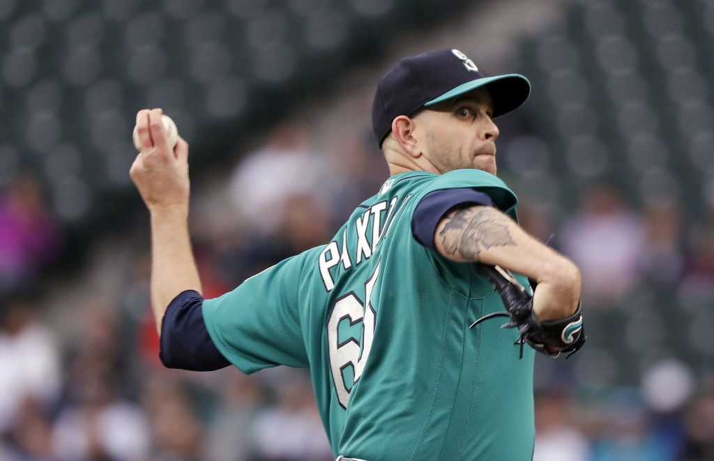 Seattle Mariners starting pitcher James Paxton throws to a Minnesota Twins batter during the first inning of a baseball game Friday, May 25, 2018, in ...