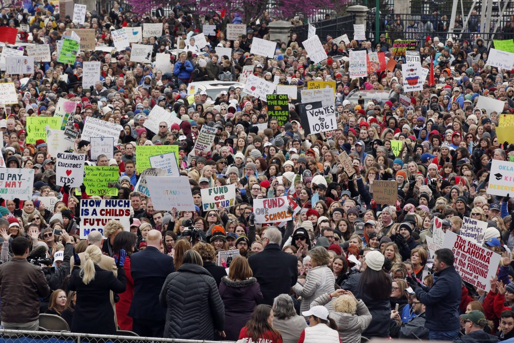 FILE - In this Monday, April 2, 2018 file photo, a crowd of teachers and supporters cheer during a protest at the state capitol in Oklahoma City. The ...